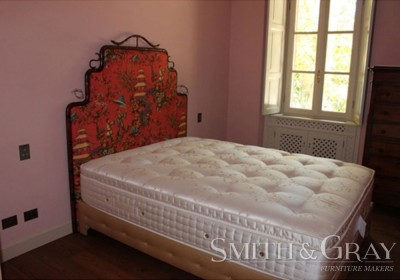 Hand upholstered oriental carved bedhead hand shaped bamboo aged