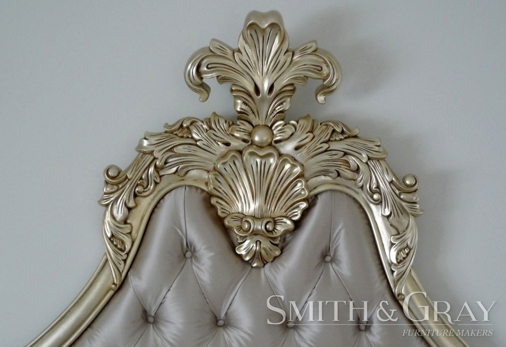 Handcarved and gilded bedhead close-up