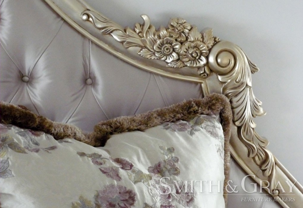 Handcarved and gilded bedhead floral rosette