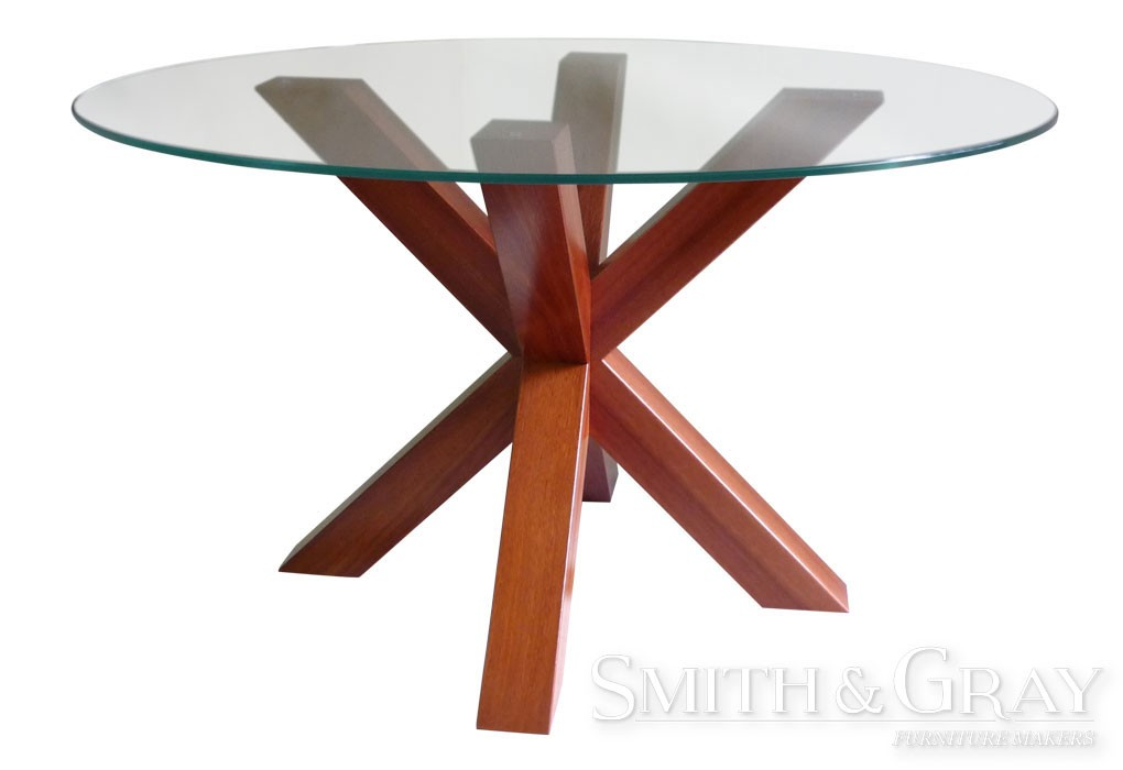 Round glass top dining table with Jarrah timber cross legs  : round jarrah glass top timber cross leg dining table 1020x700 from www.smithandgray.com.au size 1020 x 700 jpeg 54kB