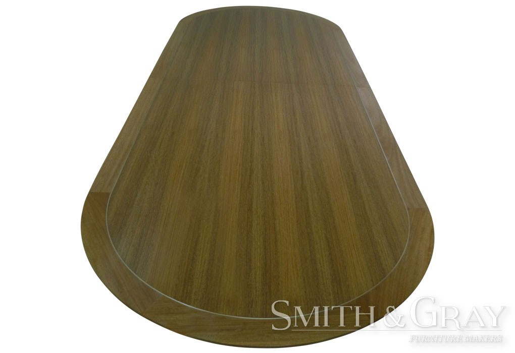 Timber boardroom table with round ends and brass inlays