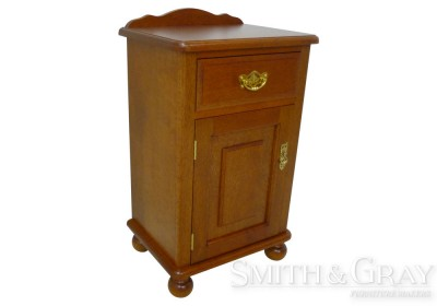 Traditional Silky Oak bedside table with turned ball feet and bale pull handles