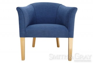 Upholstered armchair with tapered timber legs front view