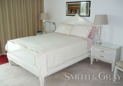 White pearl painted carved and gilded bed suite with tapered fluted legs