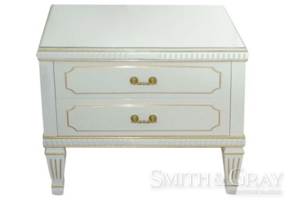 White pearl painted carved and gilded bedside table with tapered fluted legs